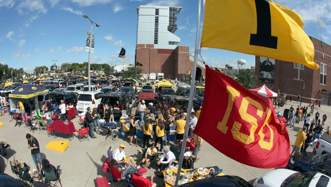 Both Iowa and Iowa State flags are flown over the Kevin Flatt tailgate before the Iowa-Iowa State game Saturday, September 11, 2010 at Kinnick Stadium in Iowa City.