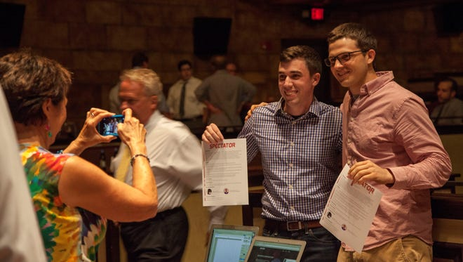 Spectator co-founders Jon Myers and Brandon Kiefer pose for a photo during NMotion's Demo Day.