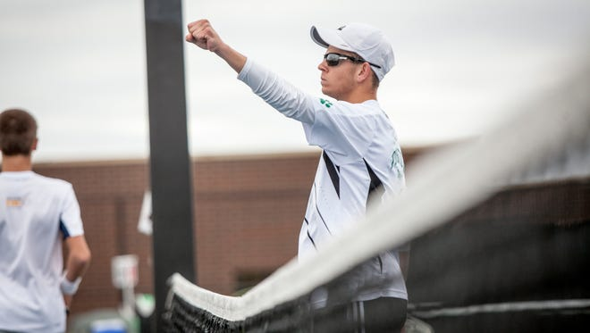 Yorktown's Ian Landwehr celebrates after his 102 career win Thursday evening at the tennis sectional held at Delta High School. Landwehr holds the record for wins in the state after the victory.