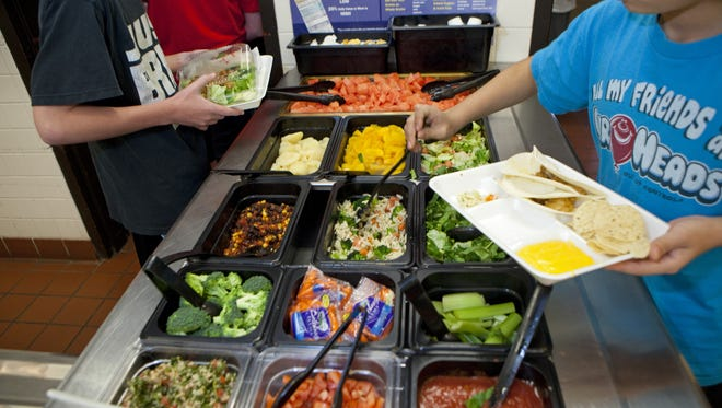 Kids are consuming fewer calories a day now than they did a decade ago, according to government data out Thursday.  AP Students at Doherty Middle School get their healthy lunch at the school cafeteria, on June 18, 2012 in Andover, Massachusetts. The Andover public school district has been making a big effort to give their students healthy lunches to help combat obesity. Every day at this school students can get fresh vegetables and fruit from the salad bar, yogurt and healthy hot meals. (AP Photo/The Christian Science Monitor,Melanie Stetson Freeman)