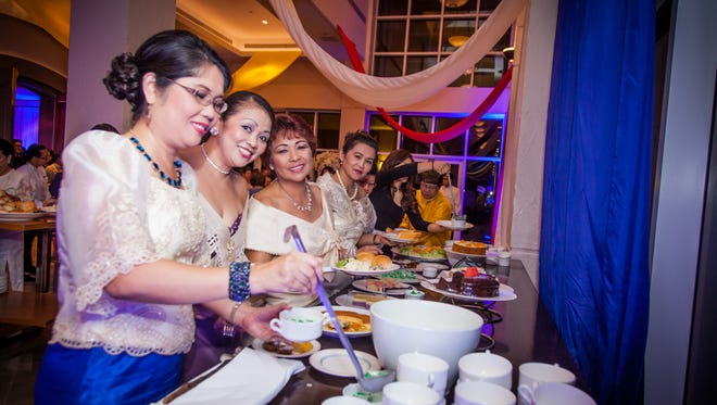 Guests enjoy the buffet of international cuisines on Oct. 23 at the 61st anniversary of the Filipino Community of Guam at the Hyatt Regency Guam.