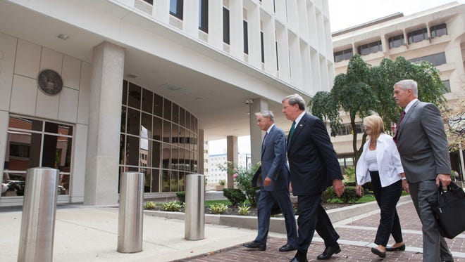 Robert Harra Jr. (second from left) arrives at the federal courthouse in Wilmington on Aug. 17, 2015, for his arraignment on charges he hid past-due loans from regulators. Jury selection now is scheduled to begin Oct. 2, 2017.