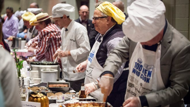 "Hundreds of community members dine at the Horizon convention Saturday during ""100 Men Who Cook"" competition and fundraiser which helped benefit the organization Champions for a Safe Community."