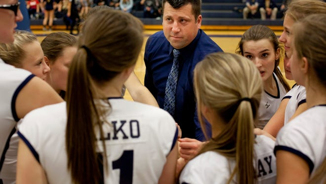 Marysville coach Ryan Welser talks with players in a huddle during a regional semifinal volleyball game Tuesday, November 10, 2015 at Imlay City High School.