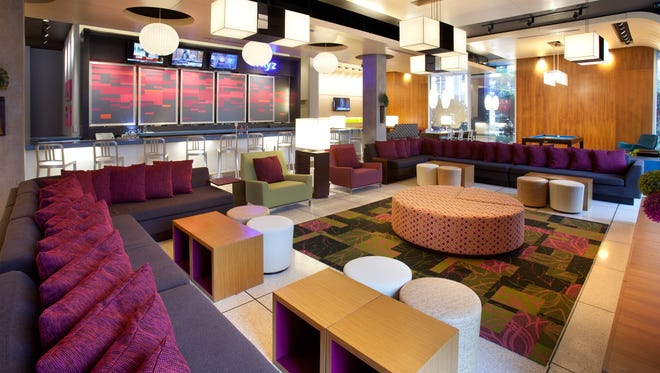 The stylish modern design of Aloft Hotels, such as this lobby in Orlando, appeals to Millennial travelers, and the youthful appeal of the brand was one of the factors that led Marriott to acquire Aloft's parent, Starwood, in a $12.2 billion deal.