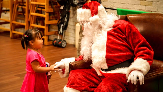 In this file photo, Felicity Lujan greets Santa at the annual Big Brothers Big Sisters of Guam Breakfast With Santa in 2013.