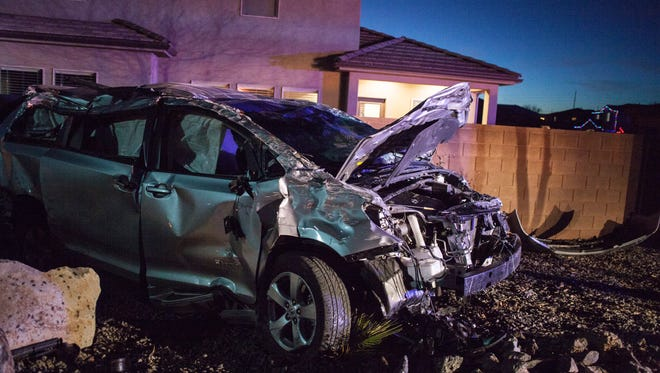 A woman and her two children are taken to DRMC after the minivan they were traveling in rolled over a curb and into a wall Friday, Dec. 18, 2015.