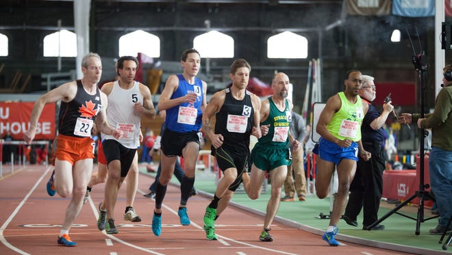 Runners in the men's 40 Elite mile at Cornell's Barton Hall