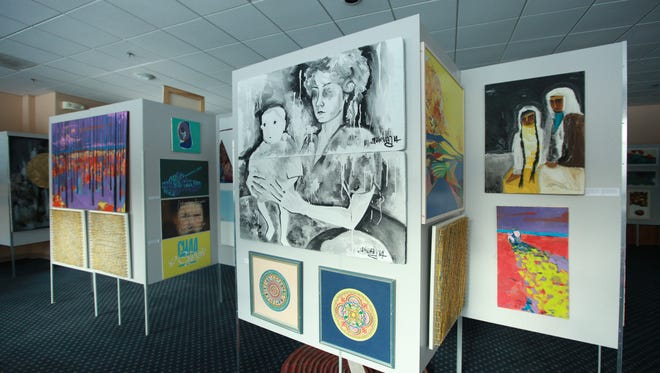 "A composite of paintings from the multimedia art exhibit ""Ukraine EXISTS"" – on display at the Ukrainian American Cultural Center of New Jersey in Whippany – is shown above.  The exhibit also features videos containing interviews with Ukrainian soldiers on the front lines of battle in the war against Russian aggression."