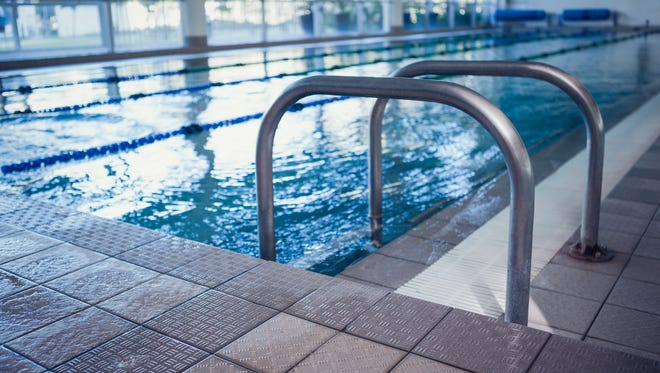 Swimming pool with hand rails