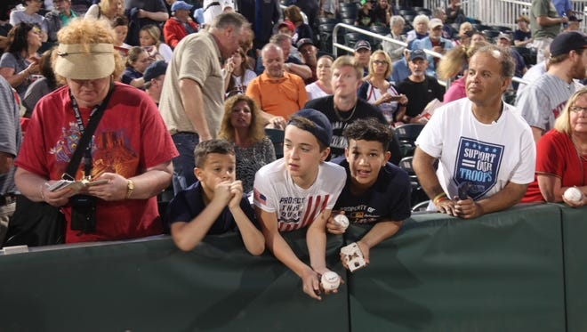 Fans waited for autographs before the  Minnesota Twins took on the Boston Red Sox during a spring training game at Hammond Field on Thursday.