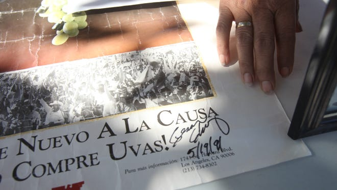 """An autographed poster by Cesar Chavez is on display at Veteran's Park in Coachella during the second annual Cesar Chavez """"Price for Justice"""" event held in memory of the social activist."""