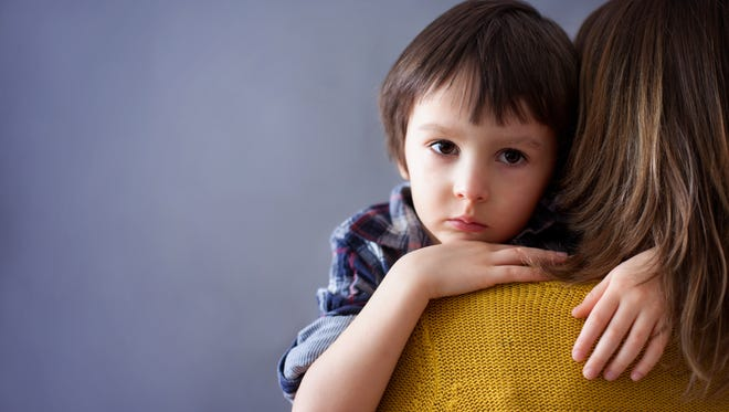 Help your children get through traumas by talking about them.