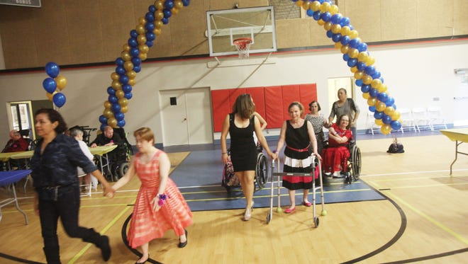"""Angel View clients enjoy their """"Prom Night"""" at the Demuth Community Center with music and food on April 9, 2016."""