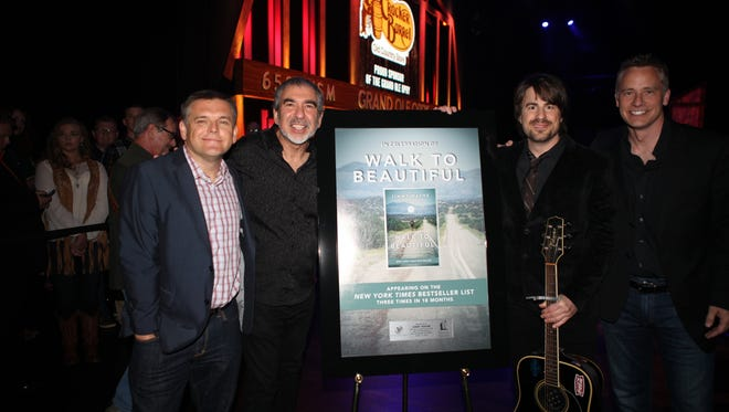 """From left, Dan Rogers, Grand Ole Opry; Ken Abraham, """"Walk to Beautiful"""" co-author; Jimmy Wayne and Matt Baugher, SVP publisher, W Publishing Group."""