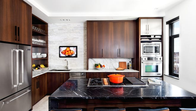 The kitchen of Baltimore interior designer Patrick Sutton and his wife, Tracy Kwiatowski Sutton, was renovated for more storage and style. Patrick's design lends itself to how the couple, lives, cooks and entertains. MUST CREDIT: Photo by Jennifer Hughes for The Washington Post.