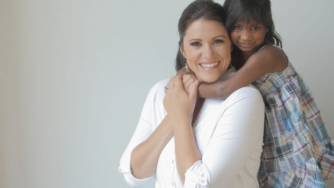 Amazing Race star Kelly McCorkle-Parkison to sign her new book about pursuing adoption in India   in Greenville on May 28.
