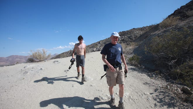 """Father and son Jeff Crider and Max train on the """"Bump and Grind"""" trail in Palm Desert as part of their preparation to clim Mount Kilimanjaro in Tanzania."""