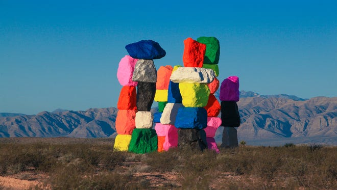 "This courtesy photo from the Nevada Museum of Art and the Art Production Fund shows the ""Seven Magic Mountains"" installation by Ugo Rondinone outside of Las Vegas."