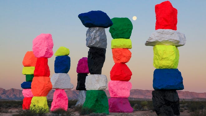 """This courtesy photo from the Nevada Museum of Art and the Art Production Fund shows the """"Seven Magic Mountains"""" installation by Ugo Rondinone outside of Las Vegas."""