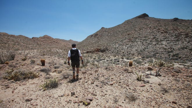 Rafael Hernandez Larraenza,  founder and director of Angeles del Desertio hikes into the Jacumba Mountains in Imperial County. The organization organizes search and rescue missions for undocumented migrants who get lost along the southwest border.