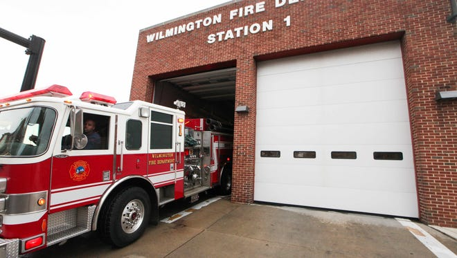 A truck is backed into Wilmington Fire Station No. 1 on Jan. 9, 2013. The city and firefighters union have reached a contract agreement.