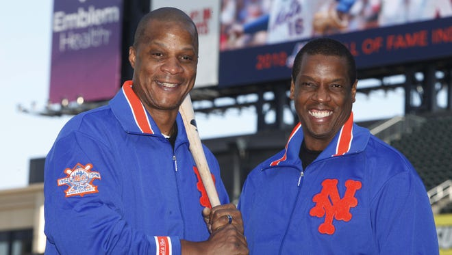"This Aug. 1, 2010, file photo shows former New York Mets' players Dwight Gooden, right, and Darryl Strawberry posing at Citi Field in New York. ESPN's latest ""30 for 30"" documentary, ""Doc & Darryl,"" examines their relationship. The film premieres Thursday at 9 p.m. EDT, two nights after the All-Star game."