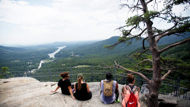 Visitors to Chimney Rock State Park enjoy the view of Lake Lure and beyond July 8, 2016.