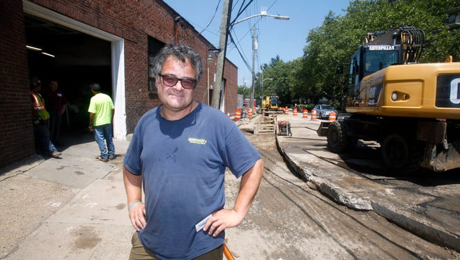 Santo Spadaro, owner of Dominick's European Car Repairs, stands outside his shop on Ferris Ave. in White Plains July 22, 2016, where the city is replacing a water main. The water main replacement follows a Con Edison project to replace an underground gas main on the street. Some residents of the area have been unhappy about the constant work in their neighborhood. Spadaro says that he understands the need for the work to be done and considers in a temporary inconvenience.