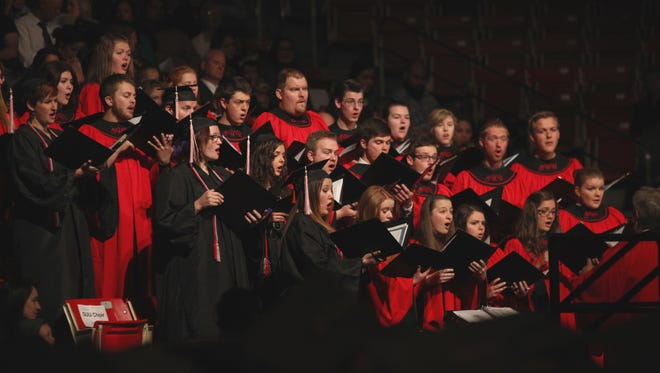 SUU's OPUS Chamber Choir performs at the 2016 graduation ceremonies at the Centrum Arena.