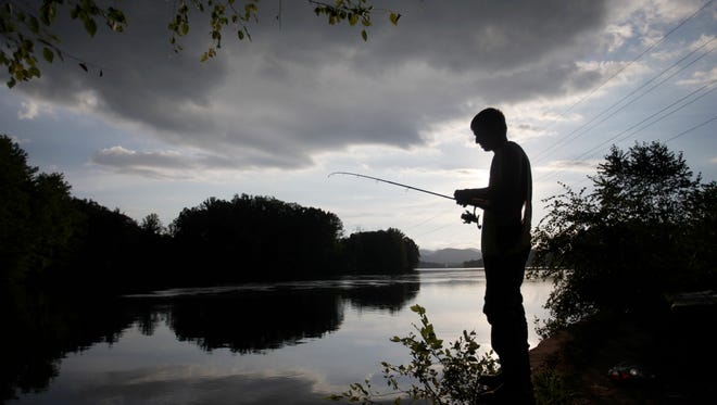 Harley Holbrook fishes at Lake Julian in Arden August 25, 2016.