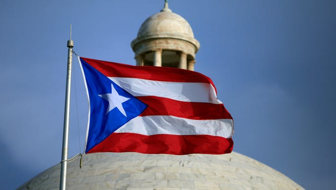 The Puerto Rican flag flies in front of Puerto Rico's Capitol building in San Juan.