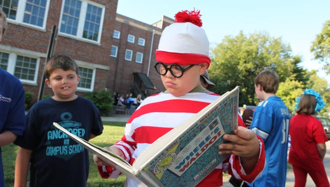 Waldo, aka fifth-grader Sammy Moore, searches for his namesake while waiting to begin the Campus School Book parade Friday morning.