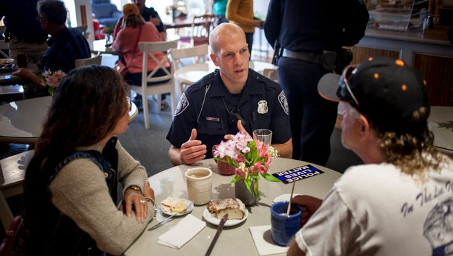 Port Huron Police Officer Nick Godwin chats with Genna and Rick Mercurio, of Port Huron Township, during Coffee with a Cop Friday, Oct. 7, 2016 at Kate's Downtown in Port Huron.