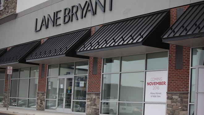 A sign advertises that Lane Bryant will be opening at the Christiana Fashion Center in November.