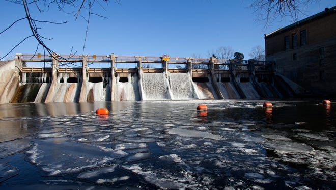 The Barton Dam along the Huron River in Ann Arbor, Mich., starts to freeze over on Jan. 1, 2015. Barton Pond is the source of most of the city's water supply, and a groundwater plume of the health-harming industrial chemical 1,4-dioxane continues to migrate toward the pond.