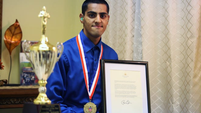 Kevin Jasani was awarded the President's Volunteer Service Award last month for his work volunteering to help the poor. He received a medal, a certificate and a letter signed by President Barack Obama.