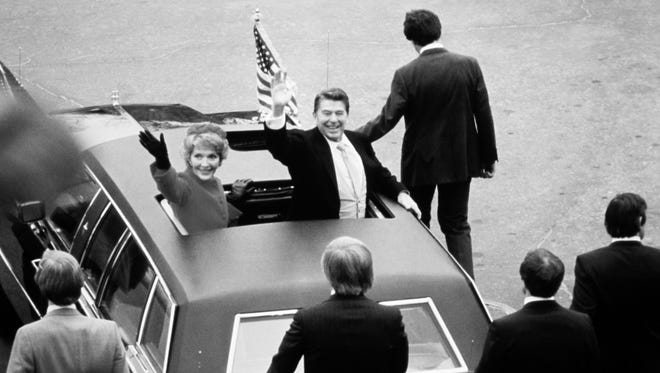 Ronald Reagan, Jan. 20, 1981. Reagan and his wife, Nancy, wave from the roof of a limousine. Reagan's inauguration was the warmest on record, with a noon temperature of 55.