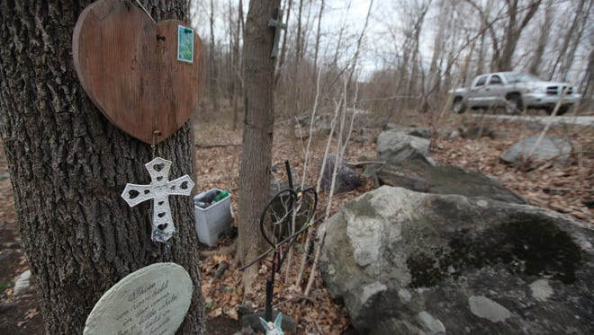A roadside memorial on Larson Road in West Milford where two teens died in 2009.