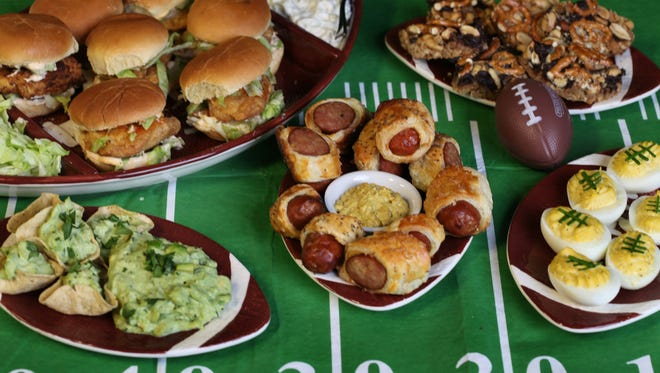 Super Bowl Food.Fried Chicken sliders.Pigs in blanket.Deviled football eggs.Nutty chocolate pretzel bars.Avocado dip.Monday January 27, 2014.