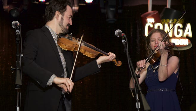 Joel Savoy, left, plays with Anya Burgess during the 2015 Only in Louisiana luncheon in Los Angeles. The Lafayette Convention and Visitors Commission hosts the event Saturday as the Only in Cajun Country Celebration.