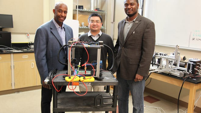 (Left-right) Professors Carl Moore, Hui Wang and Tarik Dickens are introducing new ideas and strategies to alter the way we manufacture composites via additive manufacturing - highlighted by a Gamified 3D printer (center) for STEM education.