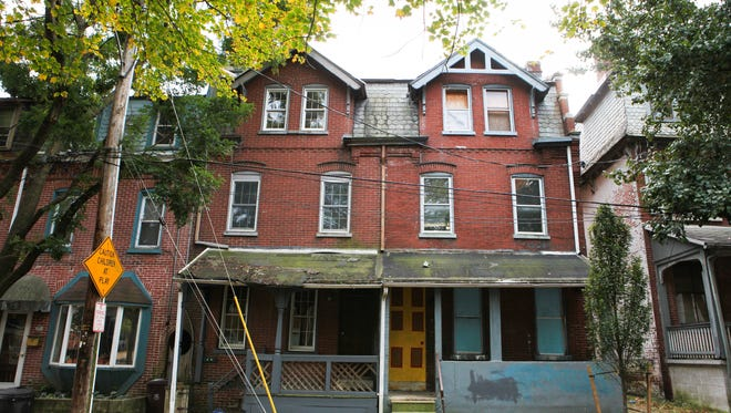 Abandoned, run-down houses can be a major obstacle to revitalizing cities.