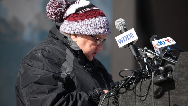 Maria Matos, president of the Latin American Community Center, speaks during a rally Thursday morning in Wilmington.
