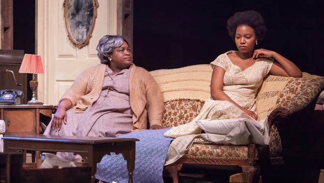 """Burgess Byrd as Mama and Renika Williams as Beneatha Younger in Cincinnati Shakespeare Company's production of Lorraine Hansberry's """"A Raisin in the Sun,"""" running through April 15."""