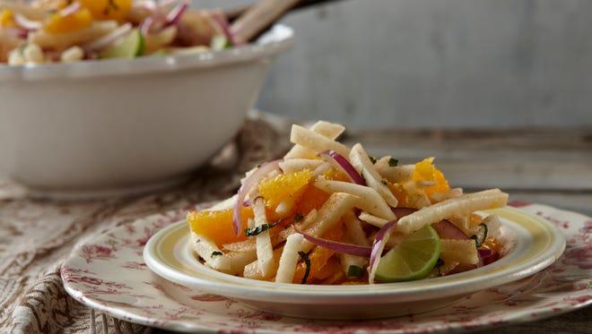 Jicama salad with sliced oranges and a lime dressing.