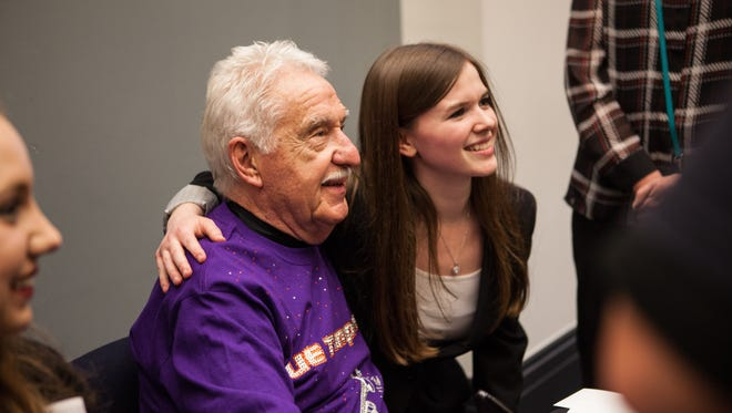 Doc Severinsen poses with Melanie Baker, pianist in the UE Jazz Ensemble I, during his CD signing following the event. Baker was one of 18 UE students who performed with the jazz legend.