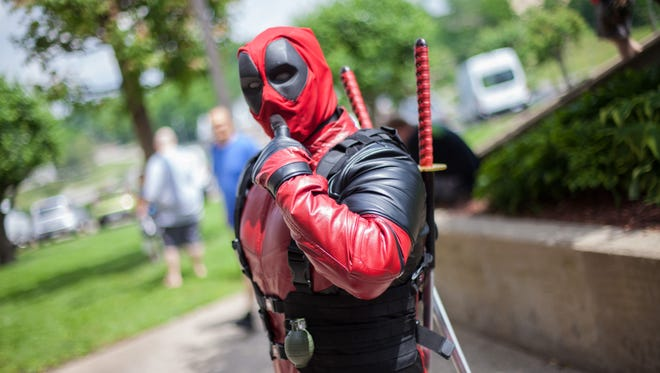 Deadpool stoppped in between quips to strike poses on Saturday.