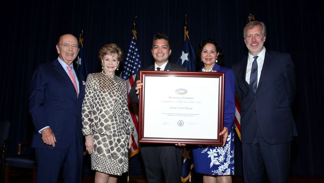 "U.S. Secretary of Commerce Wilbur Ross, first from left, presents the Guam Visitors Bureau with the President's ""E"" Award for Export Service during a May 22 ceremony at Washington D.C. From left: Secretary Wilbur Ross, Congresswoman Madeleine Bordallo, GVB Vice President Antonio Muña Jr., GVB Director of Global Marketing Pilar Laguaña and Department of Commerce Acting Undersecretary for International Trade Kenneth Hyatt."