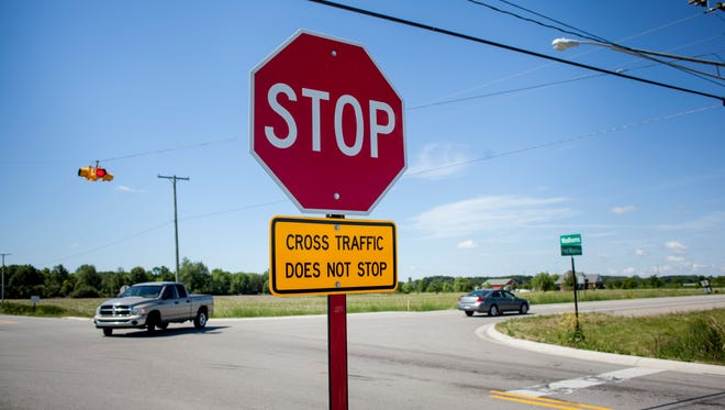 Vehicles travel Tuesday, June 27, 2017 at the intersection of Fred Moore Highway and Wadhams Road in St. Clair Township. The St. Clair County Road Commission is looking at ways to improve the safety of the intersection due to serious accidents.